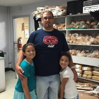 dad and daughters volunteering pic