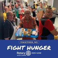 fight hunger group pic with food in kitchen