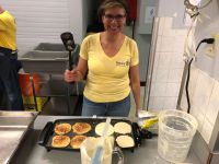 volunteer cooking pancakes