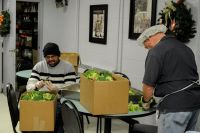 volunteers cutting veggies pic
